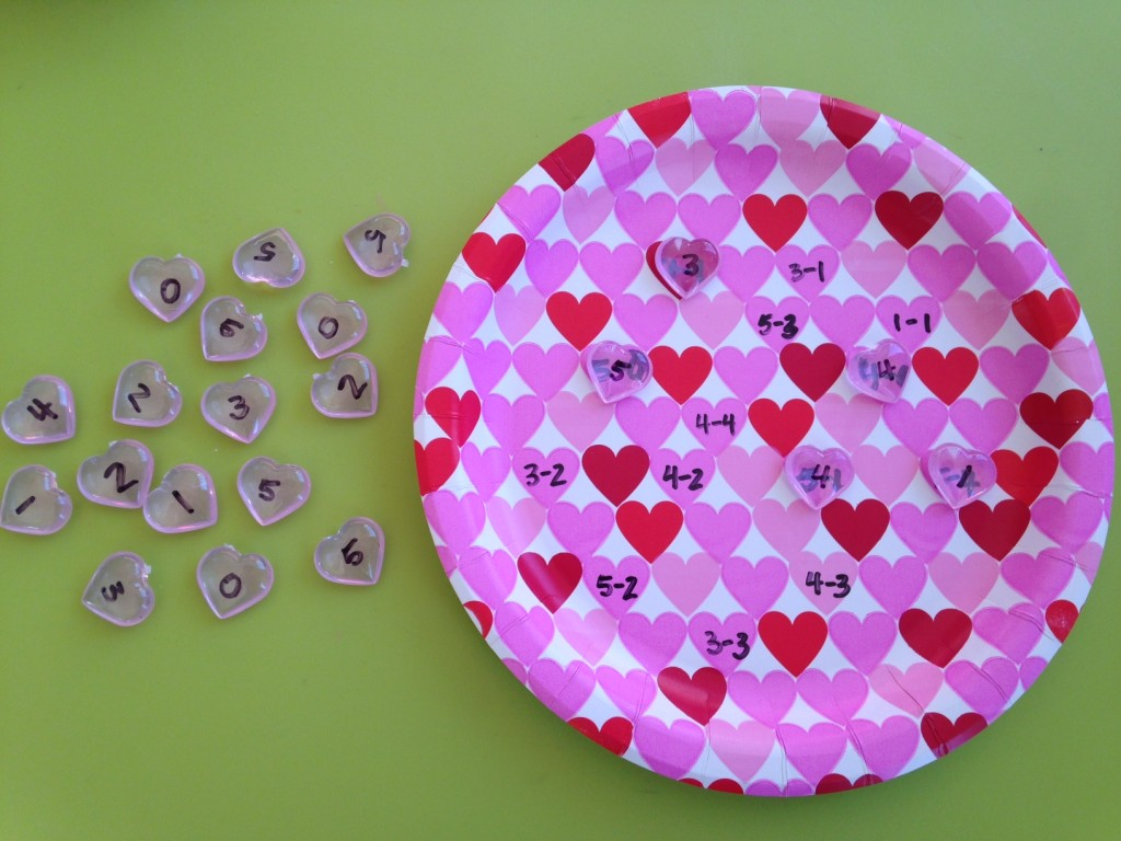 Valentine's plate subtraction hands on activity.